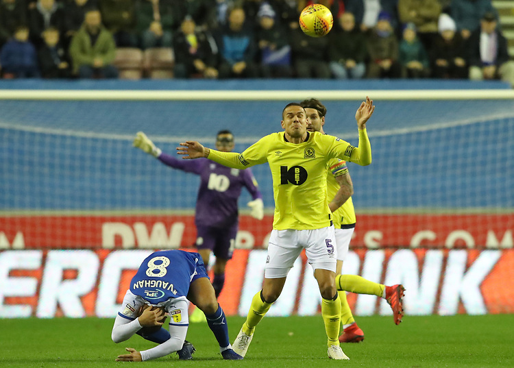 Blackburn Rovers' Jack Rodwell and Wigan Athletic's James Vaughan<br /> <br /> Photographer Rachel Holborn/CameraSport<br /> <br /> The EFL Sky Bet Championship - Wigan Athletic v Blackburn Rovers - Wednesday 28th November 2018 - DW Stadium - Wigan<br /> <br /> World Copyright © 2018 CameraSport. All rights reserved. 43 Linden Ave. Countesthorpe. Leicester. England. LE8 5PG - Tel: +44 (0) 116 277 4147 - admin@camerasport.com - www.camerasport.com