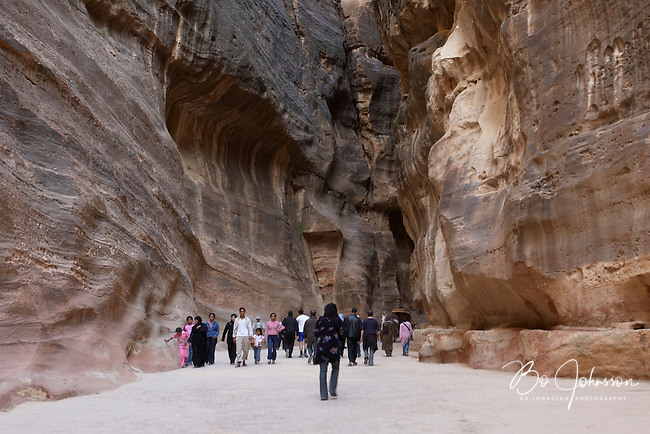 The narrow As-Siq, the lovely 1200 meter long and deep gorge is the ancient main entrance track to Petra. The soaring cliffs are up to 80 meters high and falcons are hunting high above. <br />