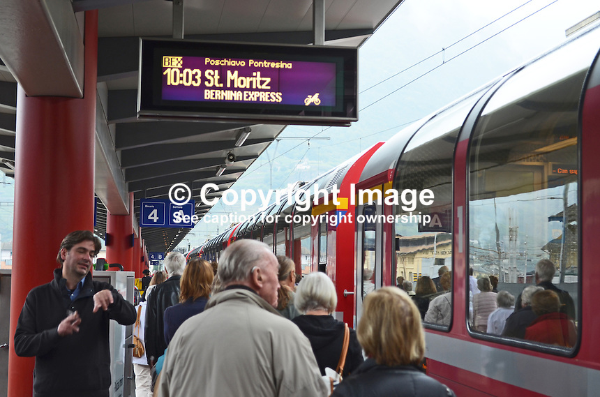 Passengers board the Bernina Express in Lugano, Italy, en route to St Moritz, Switzerland, 5th October 2014.  The Bernina Pass is at 7,330 ft above sea level. 201410053733<br /> <br /> Copyright Image from Victor Patterson, 54 Dorchester Park, Belfast, UK, BT9 6RJ<br /> <br /> t: +44 28 9066 1296<br /> m: +44 7802 353836<br /> vm +44 20 8816 7153<br /> <br /> e1: victorpatterson@me.com<br /> e2: victorpatterson@gmail.com<br /> <br /> www.victorpatterson.com<br /> <br /> IMPORTANT: Please see my Terms and Conditions of Use at www.victorpatterson.com