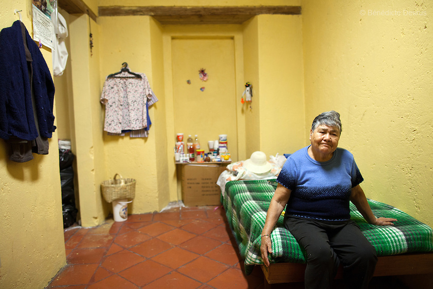 Carmelita, a resident of Casa Xochiquetzal, in her bedroom at the shelter in Mexico City on November 1, 2012. Casa Xochiquetzal is a shelter for elderly sex workers in Mexico City. It gives the women refuge, food, health services, a space to learn about their human rights and courses to help them rediscover their self-confidence and deal with traumatic aspects of their lives. Casa Xochiquetzal provides a space to age with dignity for a group of vulnerable women who are often invisible to society at large. It is the only such shelter existing in Latin America. Photo by Bénédicte Desrus