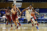17 December 2014: Duke's Sierra Calhoun (4) and Oklahoma's Nicole Kornet (left). The Duke University Blue Devils hosted the University of Oklahoma Sooners at Cameron Indoor Stadium in Durham, North Carolina in a 2014-15 NCAA Division I Women's Basketball game. Duke won the game 92-72.
