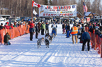 Kay Berg leaves the start line of the Junior Iditarod  at Knik Lake, Knik, Alaska