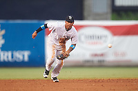Tampa Yankees shortstop Gleyber Torres (11) fields a ground ball during a game against the Daytona Tortugas on August 5, 2016 at George M. Steinbrenner Field in Tampa, Florida.  Tampa defeated Daytona 7-1.  (Mike Janes/Four Seam Images)