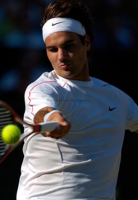 Photo: Richard Lane..Wimbledon Championships. 03/07/2006. .Roger Federer of Switzerland returns.