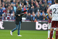 West Ham fan on the pitch during West Ham United vs Burnley, Premier League Football at The London Stadium on 10th March 2018