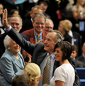 St. Paul, MN - September 2, 2008 -- Former United States President George H.W. Bush, left, waves to supporters as Sara Monsoor, right, sister of Medal of Honor recipient Michael Monsoor, looks on at the 2008 Republican National Convention in St. Paul, Minnesota on Tuesday, September 2, 2008..Credit: Ron Sachs / CNP.(RESTRICTION: NO New York or New Jersey Newspapers or newspapers within a 75 mile radius of New York City)
