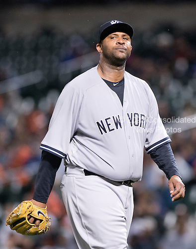 New York Yankees starting pitcher CC Sabathia (52) walks to the dugout after giving up the fourth and final run to the Baltimore Orioles at Oriole Park at Camden Yards in Baltimore, MD on Tuesday, April 14, 2015. The Orioles won the game 4 - 3.<br /> Credit: Ron Sachs / CNP<br /> (RESTRICTION: NO New York or New Jersey Newspapers or newspapers within a 75 mile radius of New York City)