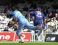 09/07/2002 - Tue.Sport - Cricket-  NatWest Series - Eng vs India Oval.Ajit Agarkar throws the ball at the stumps, Michael Vaughan blocks the flight (wicket, the fall hit him [Vaughan] in the back) ...