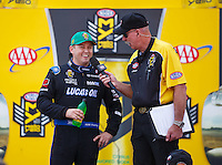 Sep 25, 2016; Madison, IL, USA; NHRA top fuel driver Richie Crampton (left) with announcer Alan Reinhart during the Midwest Nationals at Gateway Motorsports Park. Mandatory Credit: Mark J. Rebilas-USA TODAY Sports