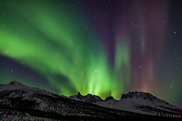 Aurora borealis over mount Snowden in the Brooks Range mountains, arctic, Alaska.