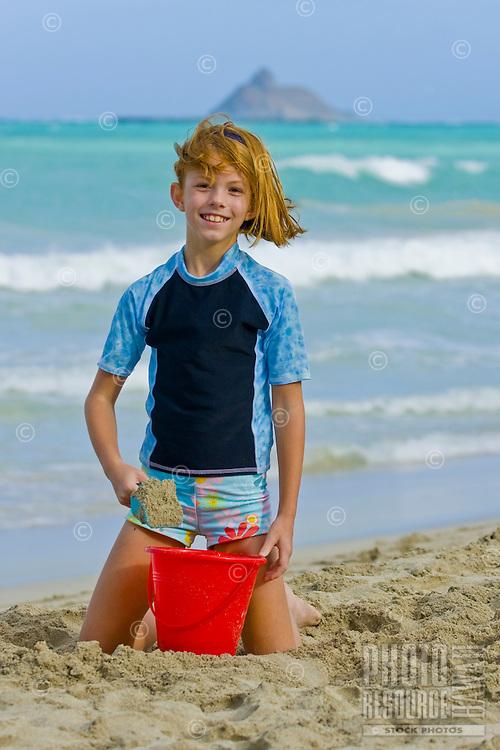 A girl plays at Kailua Beach on a splendid sunny day.
