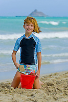 A girl plays at Kailua Beach on a splendid sunny day.