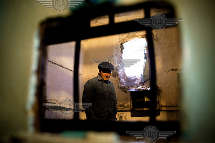 A detainee sentenced to life, who has MDR TB (multi-drug-resistant tuberculosis), stands in his cell at Specialised Prison Colony 27 in Bishkek. Kyrgyzstan's prisons are experiencing a TB epidemic, where the incidence rate is estimated at 25 times higher than in civil society.