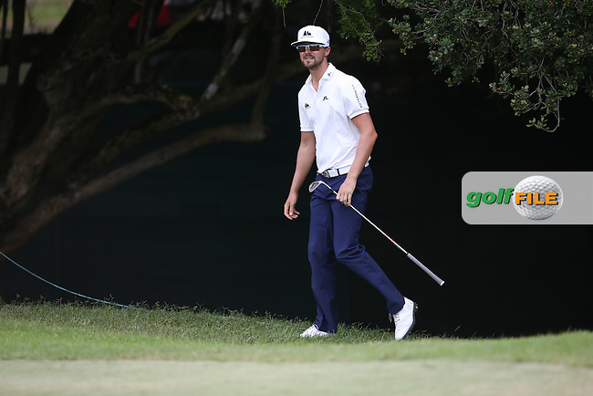 Rikard Karlberg (SWE) scrambles from the trees on the 17th during Round One of the Africa Open 2015 at the East London Golf Club, East London, Eastern Cape, South Africa. Picture:  David Lloyd / www.golffile.ie. 05/03/2015