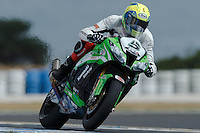 Alexander Lundh (SWE) riding the Kawasaki ZX-10R (5) of the Pedercini Team exits turn 6 during a qualifying session on day one of round one of the 2013 FIM World Superbike Championship at Phillip Island, Australia.