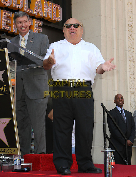 Danny DeVito.Danny DeVito Honored On The Hollywood Walk Of Fame Held On Hollywood Blvd., Hollywood, California, USA..August 18th, 2011.full length white shirt sunglasses shades black trousers arms hands funny mouth open gesture     .CAP/ADM/KB.©Kevan Brooks/AdMedia/Capital Pictures.