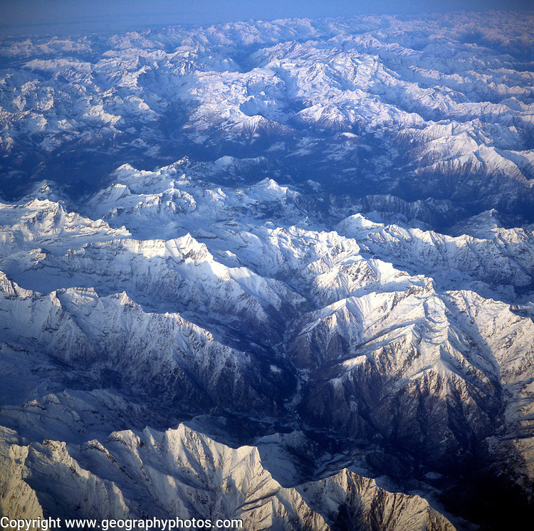 A3AAKD Aerial view of alpine mountain peaks covered by ice and snow