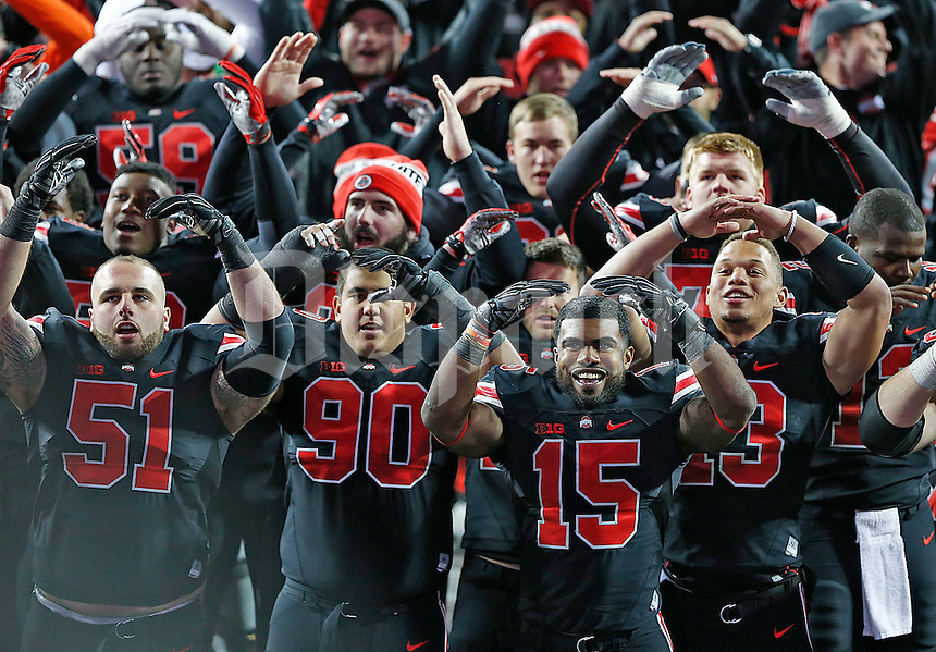 Ohio State Buckeyes offensive lineman Joel Hale (51), Ohio State Buckeyes defensive lineman Tommy Schutt (90) and Ohio State Buckeyes running back Ezekiel Elliott (15) celebrate their win over Penn State in Ohio Stadium  on October 17, 2015. (Chris Russell/Dispatch Photo)