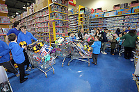 Pictured: Long queues at the tills Wednesday 08 December 2016<br />Re: Swansea City FC players have bought Christmas gifts for 60 children at Smyths toy store in Swansea, south Wales.