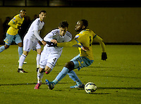 Pictured: Monday 09 February 2015<br />Re:Under-21 Swansea v Crystal Palace at Landore training ground, Swansea, south Wales, UK<br />josh sheehan tries to escape