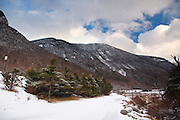 Franconia Notch State Park from the Franconia Bike Path in the White Mountains of New Hampshire during the winter months.