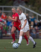 Boston College midfielder Julia Bouchelle (12) passes the ball.  Boston College defeated Marist College, 6-1, in NCAA tournament play at Newton Campus Field, November 13, 2011.