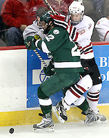 Bemidji State's Ian Lowe and UNO's Ryan Walters fight for the puck during the second period. Bemidji State beat UNO 4-2 Friday night during the first round of the WCHA playoffs at Qwest Center Omaha. (Photo by Michelle Bishop)