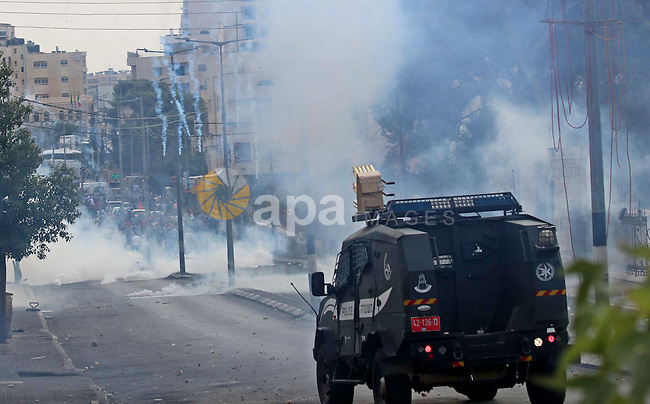 Palestinian protesters throw stones at Israeli security forces during clashes in the West Bank city of Bethlehem, on October 13, 2015. A wave of stabbings that hit Israel, Jerusalem and the West Bank this month along with violent protests in annexed east Jerusalem and the occupied West Bank, has led to warnings that a full-scale Palestinian uprising, or third intifada, could erupt. The unrest has also spread to the Gaza Strip, with clashes along the border in recent days leaving nine Palestinians dead from Israeli fire. Photo by Muhesen Amren