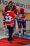 22 November 2008: The Montreal Canadiens, celebrating their 100th season, honor goaltender Patrick Roy seen here greeting current Montreal Canadiens' center and Team Captain Saku Koivu from Finland. The Canadiens retired his jersey (Number 33) during pre-game ceremonies prior to a game against the Boston Bruins at the Bell Centre in Montreal, Quebec, Canada. Roy, played on two Stanley Cup teams with Montreal (1986 and 1993), and appeared in 114 playoff games for the Habs, the most of any goalie in Canadiens history. ***** Editorial Use Only *****..Mandatory Photo Credit: Ed Wolfstein Photo *** Editorial Sales through Icon Sports Media *** www.iconsportsmedia.com