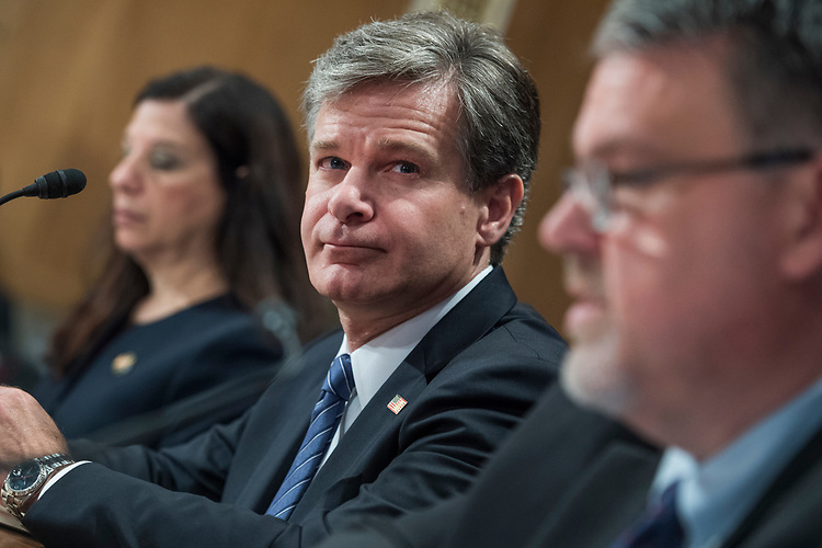 "UNITED STATES - SEPTEMBER 27: From left, Elaine Duke, Acting Secretary of the Department of Homeland Security, Chris Wray, FBI Director, and Nicholas Rasmussen, Director of of the National Counterterrorism Center, testify during a Senate Homeland Security and Governmental Affairs Committee hearing in Dirksen titled ""Threats to the Homeland"" on September 27, 2017. They fielded questions including hurricane response and border security. (Photo By Tom Williams/CQ Roll Call)"