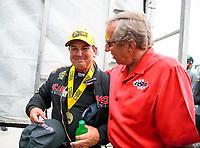 Aug 19, 2018; Brainerd, MN, USA; NHRA top fuel driver Billy Torrence (left) is congratulated by Don Schumacher after winning the Lucas Oil Nationals at Brainerd International Raceway. Mandatory Credit: Mark J. Rebilas-USA TODAY Sports