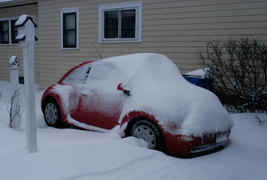Snow covers a Volkswagen beetle in a Milwaukee driveway. Ernie Mastroianni photo