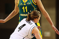 Opals forward Elyse Penaluna towers over Erin Rooney during the International women's basketball match between NZ Tall Ferns and Australian Opals at Te Rauparaha Stadium, Porirua, Wellington, New Zealand on Monday 31 August 2009. Photo: Dave Lintott / lintottphoto.co.nz