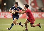 Nathan Hirayama of Canada (right) tries to stop Madison Hughes of USA, who runs with the ball during the match United States vs Canada, the Cup Final of the HSBC Singapore Rugby Sevens as part of the World Rugby HSBC World Rugby Sevens Series 2016-17 at the National Stadium on 16 April 2017 in Singapore. Photo by Victor Fraile / Power Sport Images