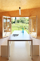 Double glass doors in the kitchen/dining area frame a view of the surrounding countryside