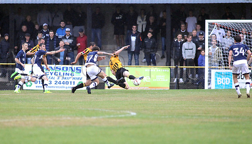 11th July 2017, Fullicks Stadium, Folkestone, England; Football Pre Season Friendly; Folkestone Invicta FC versus Millway XI; Folkestone Invicta defender Callum Davies make a diving block to stop Lewis White's shot during the first half