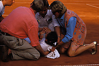 April 30th 1993, Hamburg, Germany; Monica Seles (USA) is helped by medical workers after she is attacked with a knife at the Hamburg Citizen Cup where she was playing Magdalena Maleeva