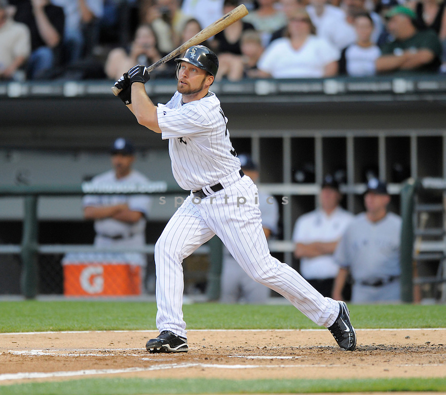MARK KOTSAY,  of the Chicago White Sox  in action  during the White Sox game against the New York Yankees.  The  Yankees beat the White Sox 15-3 in Chicago, Illinois on July 31, 2009...David Durochik