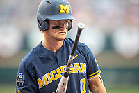 Michigan Wolverines catcher Joe Donovan (0) on deck during Game 6 of the NCAA College World Series against the Florida State Seminoles on June 17, 2019 at TD Ameritrade Park in Omaha, Nebraska. Michigan defeated Florida State 2-0. (Andrew Woolley/Four Seam Images)