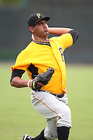 GCL Pirates pitcher Rinku Singh #18 warms up before a game against the GCL Braves at Disney Wide World of Sports on June 25, 2011 in Kissimmee, Florida.  The Pirates defeated the Braves 5-4 in ten innings.  (Mike Janes/Four Seam Images)