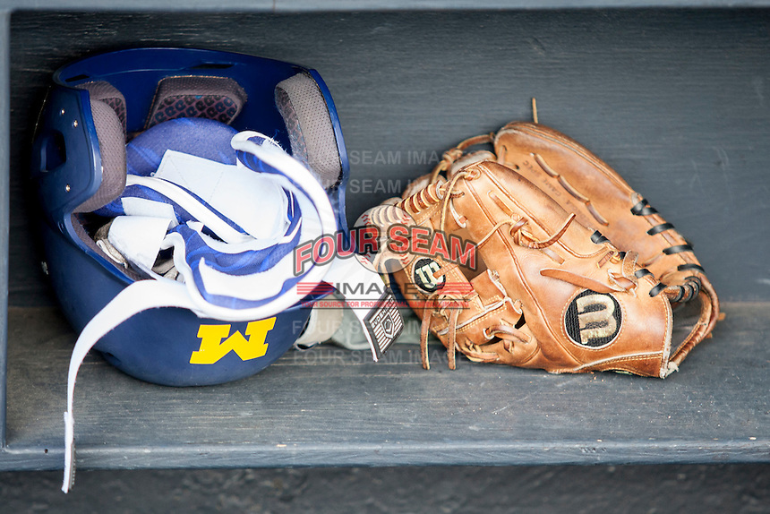 Michigan Wolverines helmet and glove on May 3, 2016 at Ray Fisher Stadium in Ann Arbor, Michigan. (Andrew Woolley/Four Seam Images)