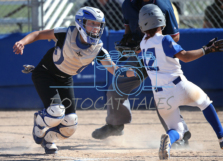 Western Nevada catcher Bailey Henderson puts the tag on College of Southern Nevada's Maggie Manwarren during action at Edmonds Sports Complex in Carson City, Nev., on Friday, April 1, 2016. <br />Photo by Cathleen Allison/Nevada Photo Source