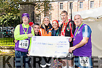 Presenting a cheque of €1500 to Cystic Fibrosis Ireland on Sunday morning last were l-r: Gerard Fay, Derek Mackessy, Susan Baughman, Donna McLoughlin (Achill Ultra), Michael McEnery and Patrick Mockett.