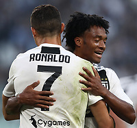 Calcio, Serie A: Juventus - Genoa, Turin, Allianz Stadium, October 20, 2018.<br /> Juventus' Cristiano Ronaldo (l) celebrates after scoring with his teammate Juan Quadrado (r) during the Italian Serie A football match between Juventus and Genoa at Torino's Allianz stadium, October 20, 2018.<br /> UPDATE IMAGES PRESS/Isabella Bonotto