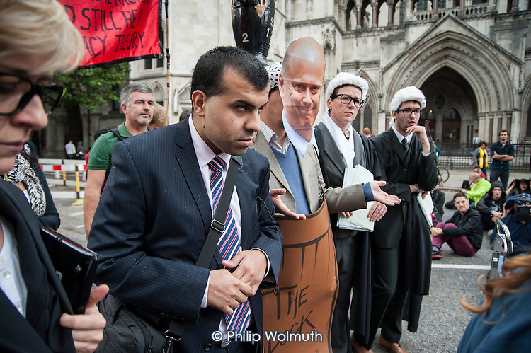 A visually impaired witness gives evidence at a mock trial of Justice Minister Chris Grayling.  UK Uncut ad Disabled People Against the Cuts block the road outside the Royal Courts of Justice in protest at proposed cuts to Legal Aid.