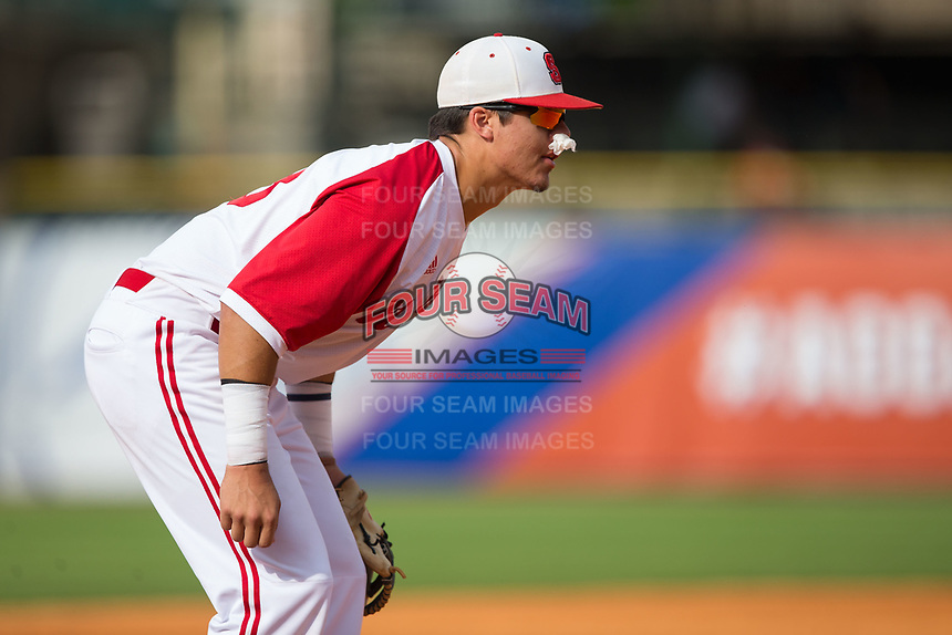 North Carolina State Wolfpack third baseman Evan Mendoza (18) sustained a bloody nose after a collision with pitcher Johnny Piedmonte (not pictured) while attempting to field a bunt during the game against the Boston College Eagles in Game Two of the 2017 ACC Baseball Championship at Louisville Slugger Field on May 23, 2017 in Louisville, Kentucky.  The Wolfpack defeated the Eagles 6-1. (Brian Westerholt/Four Seam Images)