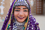 Rajasthani dancer wearing colorful, traditional costume and jewelry, portrait, Thar Desert, Rajasthan, India --- Model Released