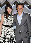 PASADENA, CA - JANUARY 08: Zooey Deschanel and Jake Johnson. arrive at the 2013 TCA Winter Press Tour - FOX All-Star Party at The Langham Huntington Hotel and Spa on January 8, 2013 in Pasadena, California.