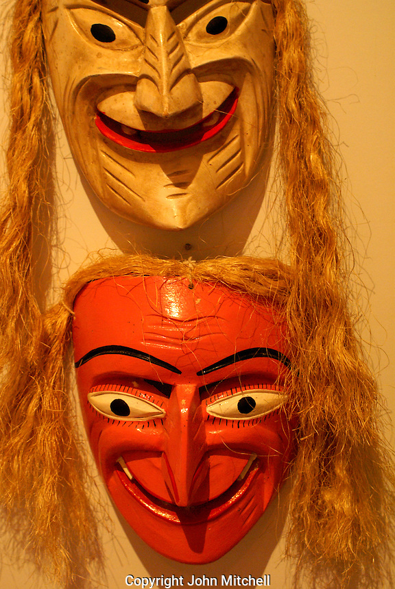 Grinning Mexican masks Museo Casa de la Mascara, Acapulco, Mexico. These masks depict old men and are worn during the Dance of the Viejitos performed in the state of Michoacan.