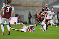 Mark Noble of West Ham and Aaron Lennon of Burnley  during West Ham United vs Burnley, Premier League Football at The London Stadium on 10th March 2018